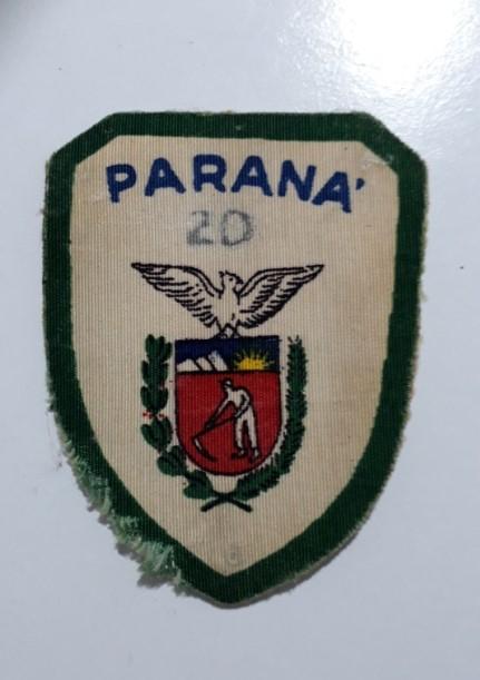 Um dos primeiros distintivos do grupo. Possui o texto: Paraná 20.